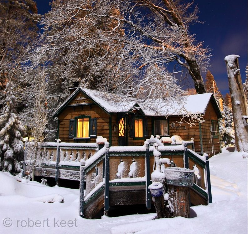 Blue Jay cabin covered in snow