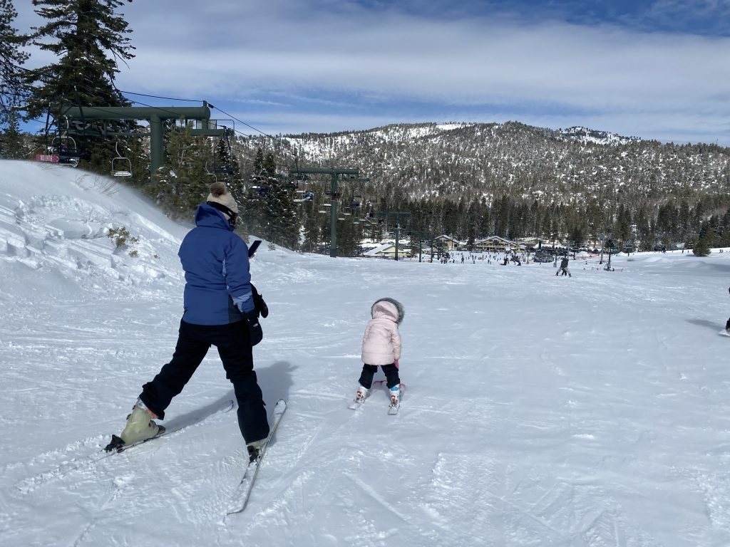 mom and child skiing at snow valley